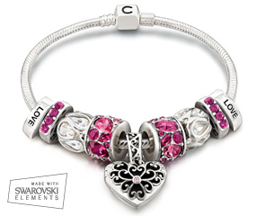 Love pink? Chamilia's Pink Heart Locket Silver Snap Bracelet is a colorful way to express yourself. Everyone will fall in love with this bracelet, featuring sparkling beads with pink, fuschia, and clear Swarovski Elements, as well as the popular In My Heart Locket. Vibrant and playful with a hint of vintage, this bracelet captures the heart – and holds a photo or memento of that special someone.