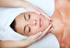 beautiful-young-woman-receiving-facial-massage-12322317.jpg