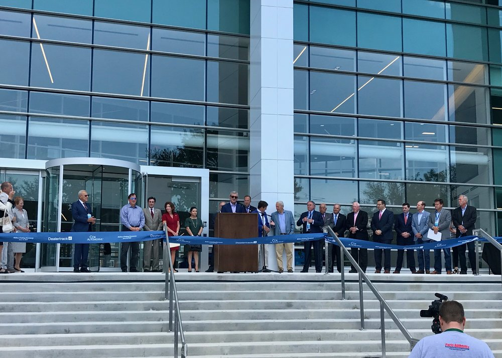 Mark F. O'Neil, Executive Vice President and Chief Operating Officer of Cox Automotive, announces the opening of the new Dealertrack building.