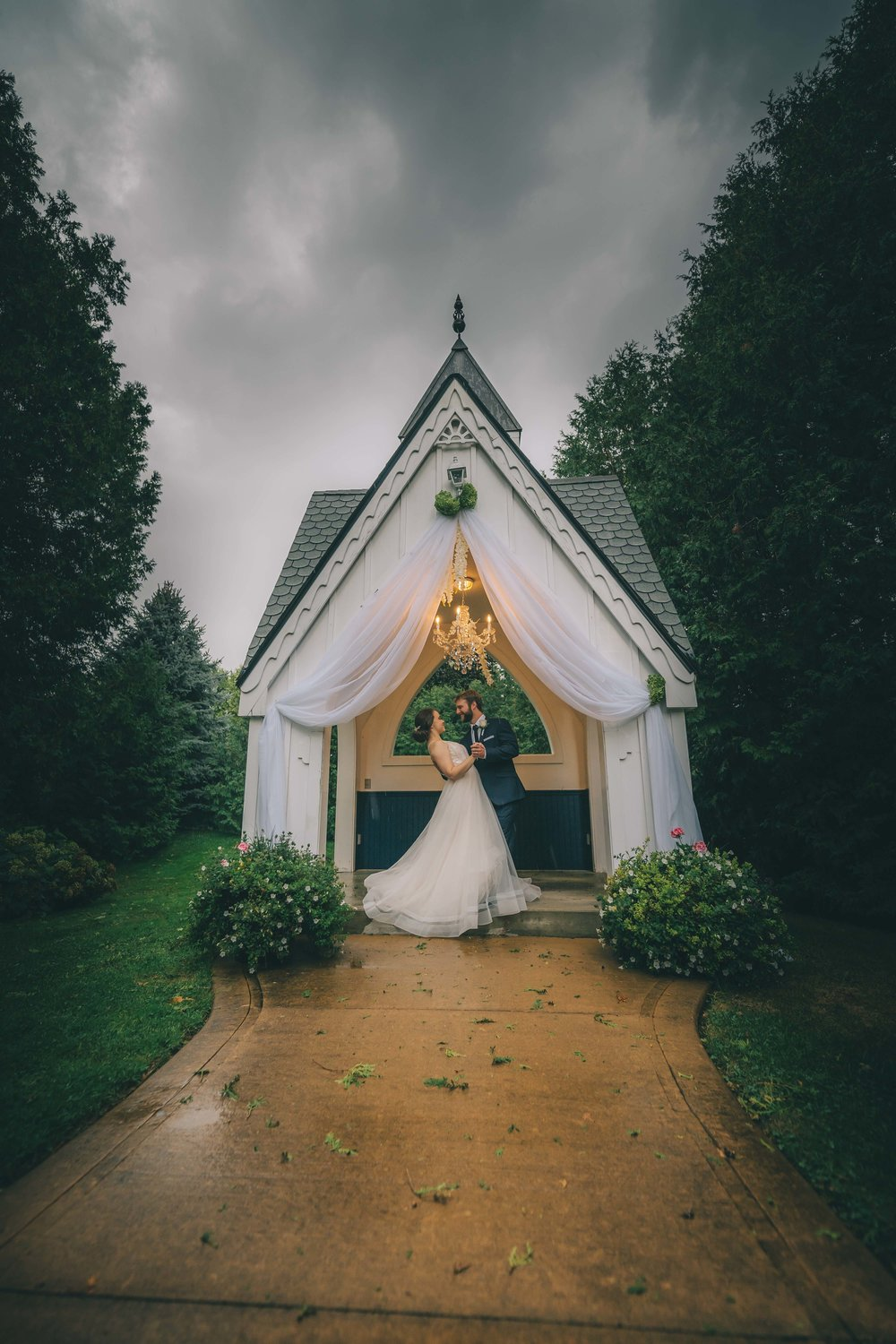 """Dustin was fantastic to work with! From our initial phone call with Dustin, we knew he and his team would be a great fit. We had a rough weather day for our wedding, but that didn't stop the creativity and willingness to still get the perfect shots. We were so happy with our experience from start to finish!"" - Rebecca + Rob (from WeddingWire)"