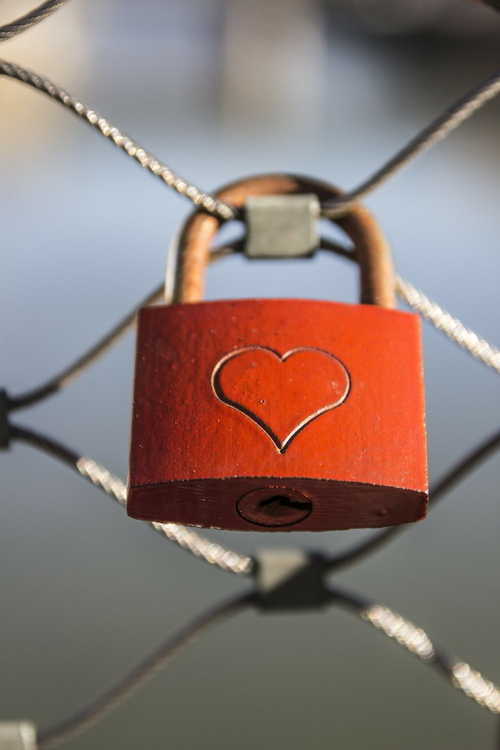 red padlock with a heart etched on it