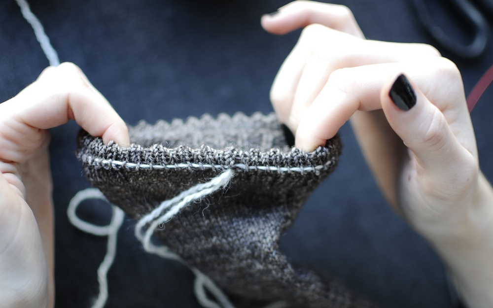 1. Start by giving the cuff a little stretch. This should make Yarn B fairly easy to see.