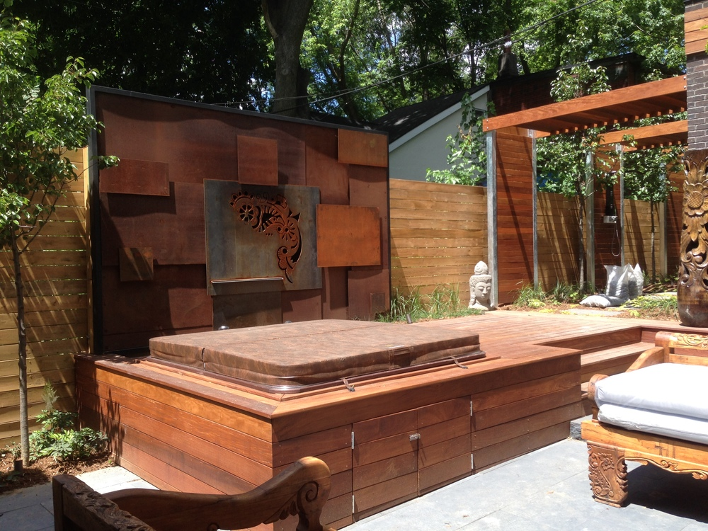 The custom corten steel water feature almost complete to create a seamless look of cascading water into the built-in spa.