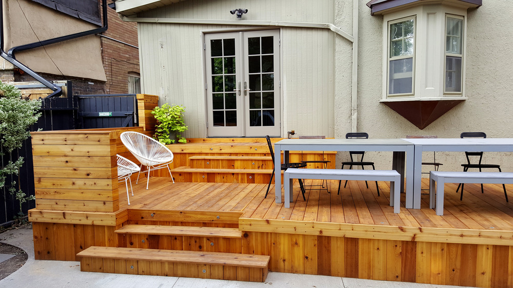 The new cedar deck opens up the yard