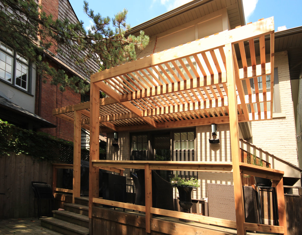 The clean lines give a modern feel to the cedar, a traditional material, and tie in with the existing deck.