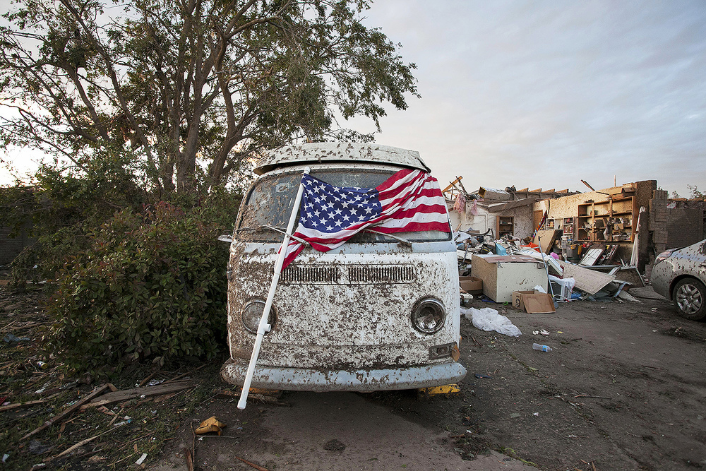 An American flag is sprawled across a VW Bus in the aftermath of the May 20th Moore Tornado in Oklahoma.