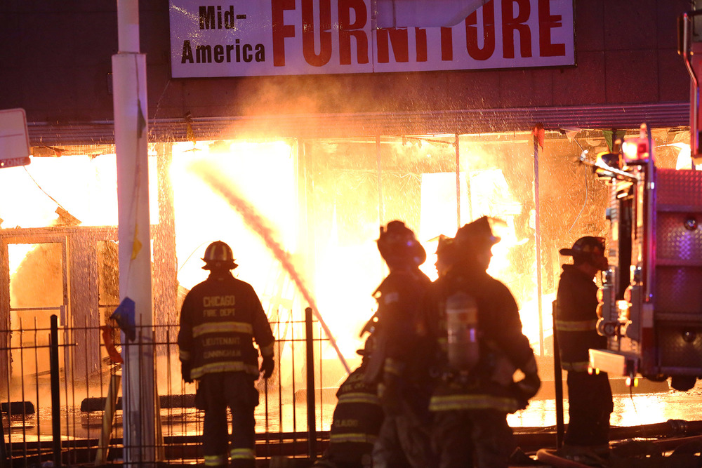 Firefighters battle a multi-alarm fire at a strip mall along the 3100 block of West Peterson on Friday, November 15, 2013, in Chicago.  (For the Chicago Sun-Times)