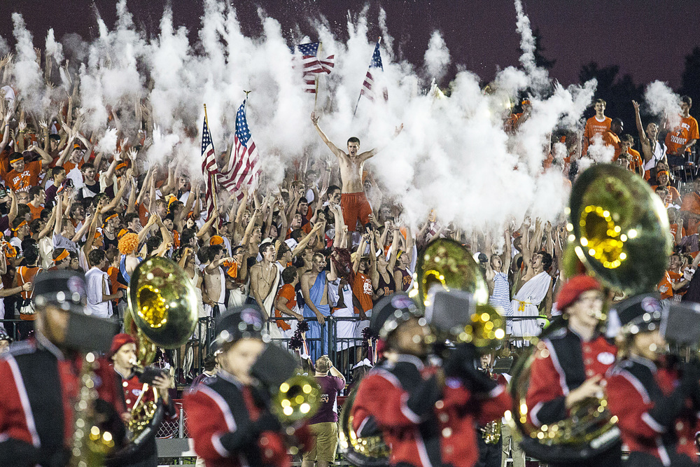 Fans of Brother Rice cheer and toss chalk in the air before the Crusaders battle the Marist RedHawks on Friday, September 6, 2013.