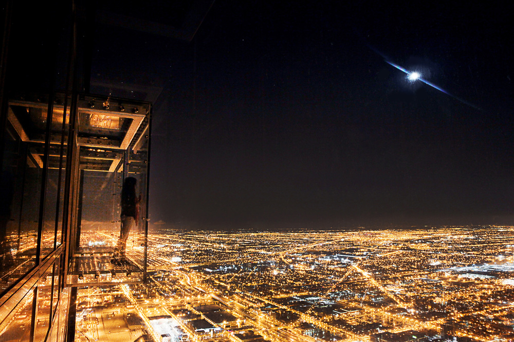 A lunar eclipse rises over Chicago, as seen from the Willis Tower Skydeck, on Tuesday, April 15, 2014.