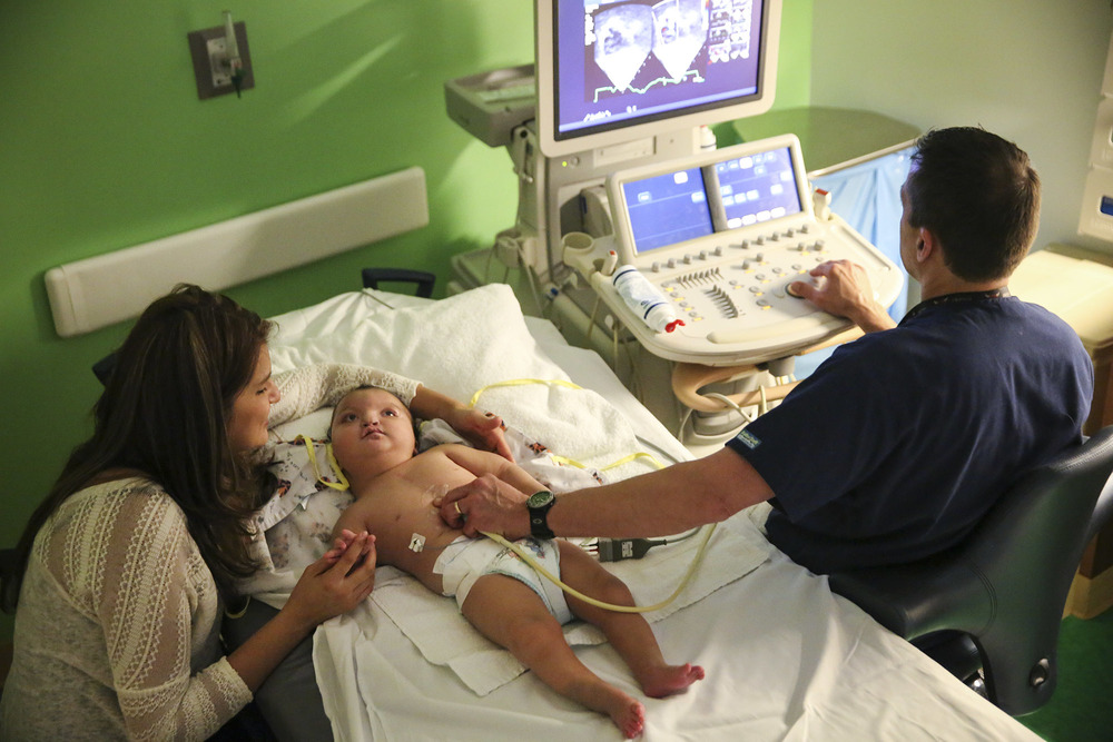Camillah DeLeon, 14mo., who was born with Wolf-Hirschhorn syndrome, and her mother Sandra Tobar, during her cardiology check-up at Lurie Children's Hospital on Tuesday, September 30, 2014.