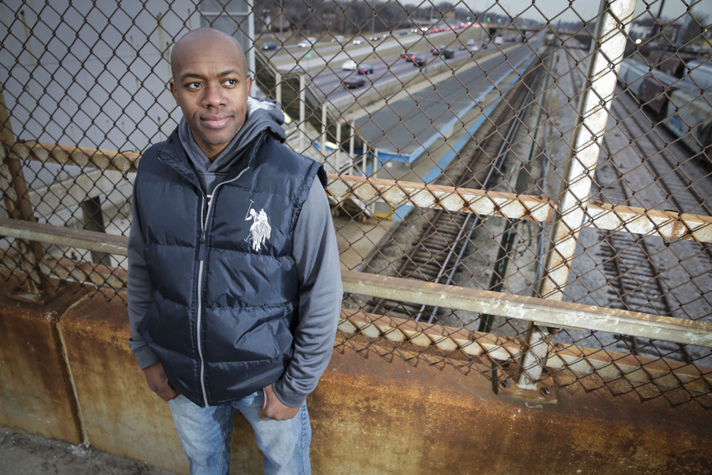 Craig Mathis stands near the Harlem Avenue Blue Line station, where he saved a woman who was being attacked in June of last year,  on Friday, January 2, 2015. Mathis donated his kidney to a close friend just 11 months earlier.