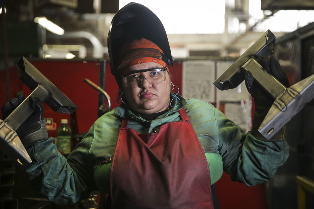 Valerie Galvan, 38, a welder at Freedman Seating Company, located in Chicago's Austin neighborhood, shows off some of her work. Galvan is a former student of Jane Addams Resource Corporation.