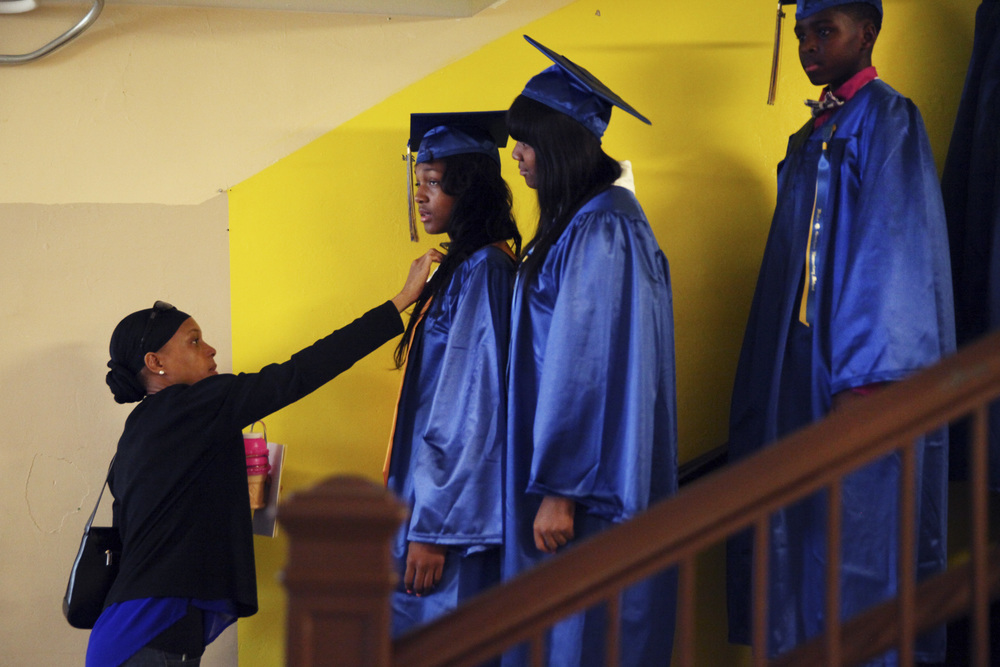 Walter Q Gresham Elementary School students prepare for their 8th grade graduation on Monday, June 9, 2014.