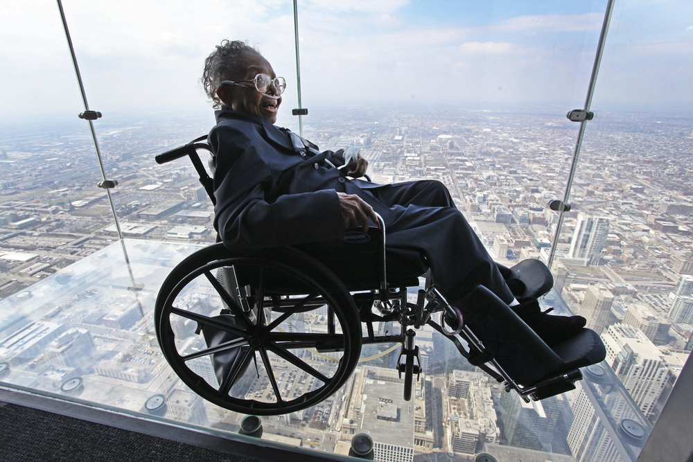 Willie Tillman, 102 years old Merrillville, Ind. resident, visits the top of the Willis Tower for the first time. Tillman, who lives less than 45 miles away, had wanted to visit the tower since it was built.