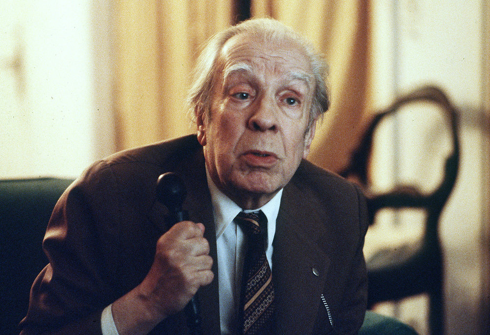 Argentina's writer Jorge Luis Borges talks in his Buenos Aires apartment on Nov. 20, 1981 (AP)