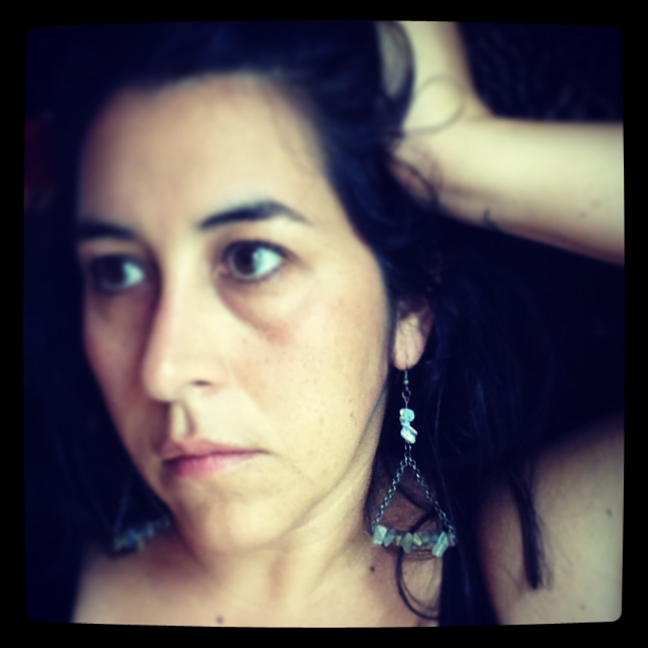 Yep, that is always me posing with my earrings...too cheap to hire a real model. I need to work on my smize.