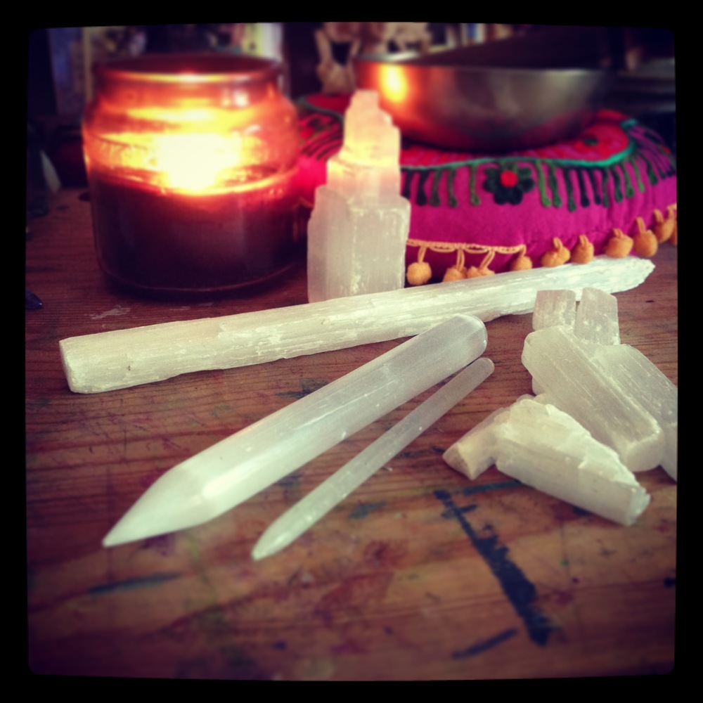 Starting at 12 o'clock on this photo, the Selenite tower is great for the center of a grid. The long natural Selenite wand can be placed on the spine for alignment. The smaller Selenite wands are great for gridding homes and people during crystal healing sessions, you can also hold one of these pieces for meditation, or when lying on a yoga mat, massage table, or bed, place the Selenite on the crown (either directly on, or pointing out) to facilitate communication with your angels and guides, the two polished Selenite massage wands can be used for massage or to close open portals in the etheric field.