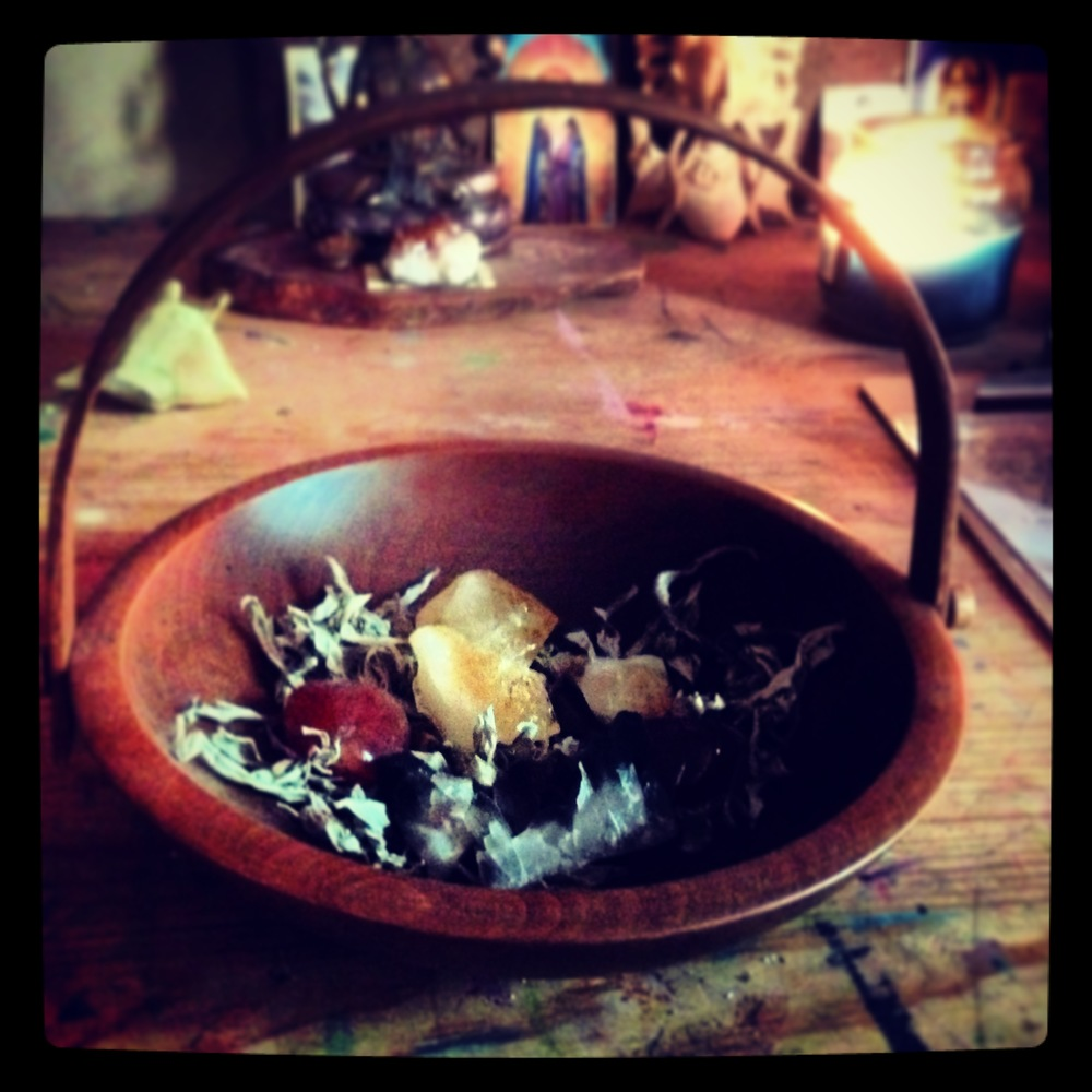 This Abundance basket contains Smoky Quartz, Citrine and Carnelian with sage.
