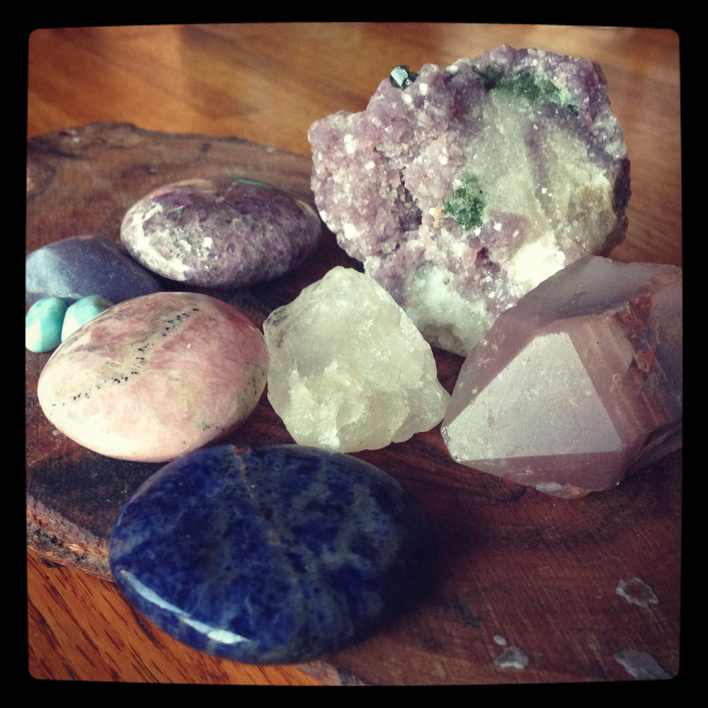 Stones for anxiety, high blood pressure and pre-eclampsia from Upper Right, Lepidolite, Lithium Quartz, Sodalite, Petalite in the middle, Rhodochrosite, Larimar, and two more pieces of Lepidolite.