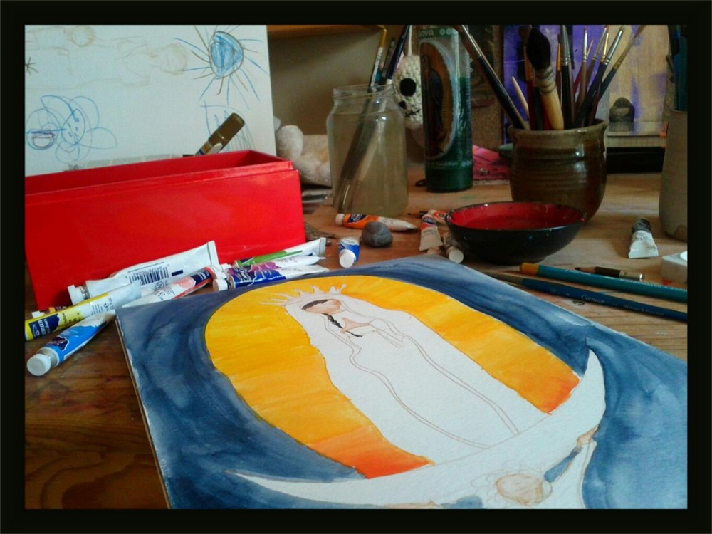 Working on a painting of the Virgin of Guadalupe