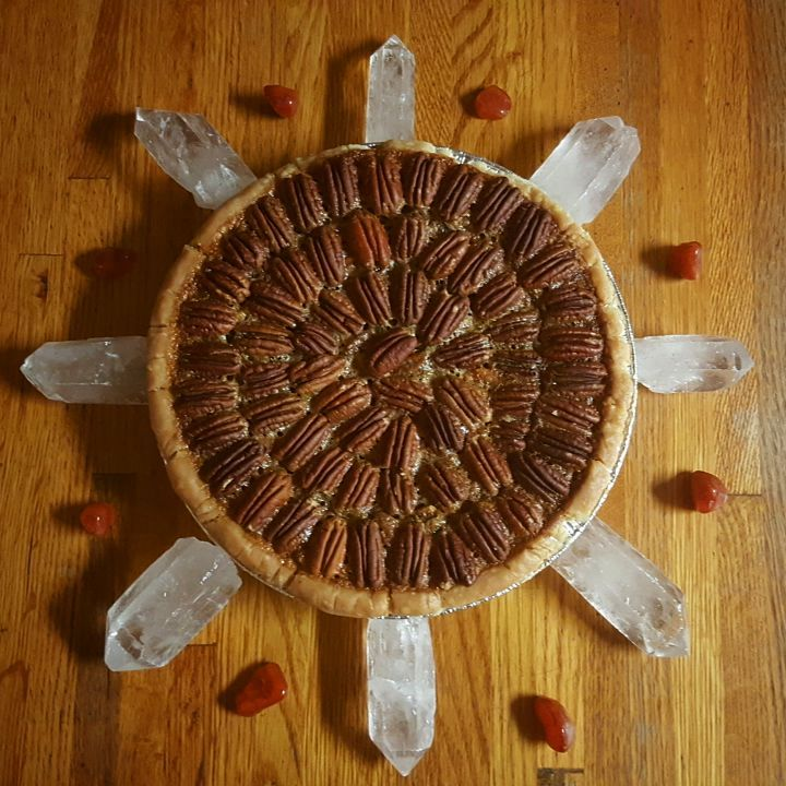 I love to Reiki and grid my food before serving it. This is a pecan pie I baked for Thanksgiving, gridded with Clear Quartz and Carnelian.