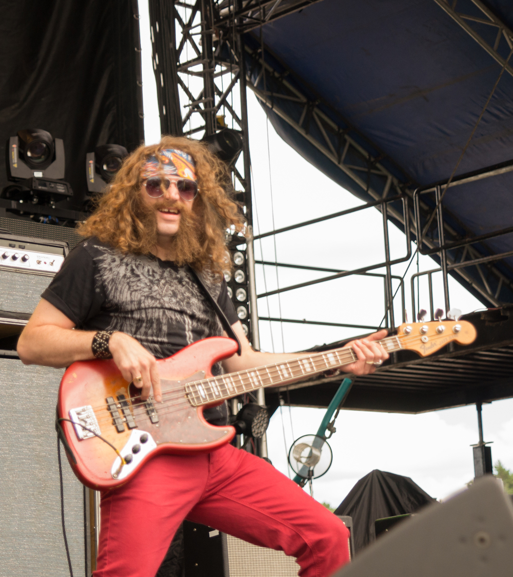 No idea what this guys name is but he is the coolest looking Bass guitarist in country music today!
