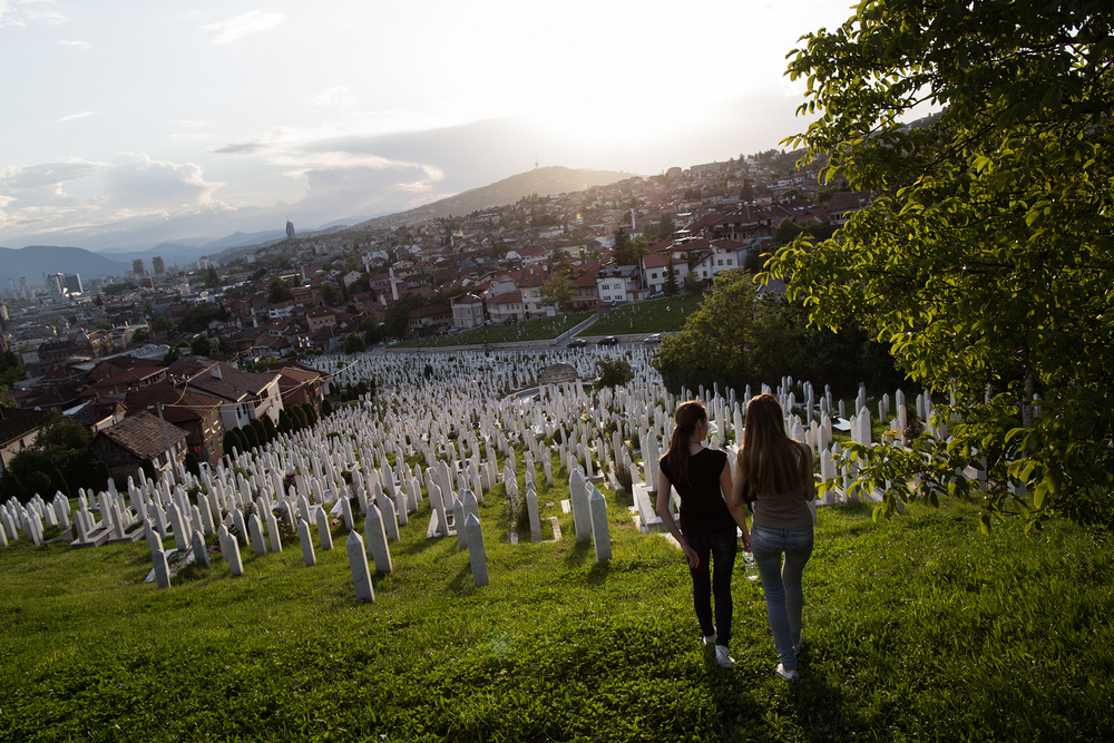 "In Bosnia-Herzegovina, shadows of doubt and malaise hang over life. The three ethnic groups with ""constituent status"" as defined by the Dayton Agreement that ended the war in 1995 — Bosnian Muslim (Bosniak), Croat, and Serb — have conflicting views on a large number of issues and problems that shape today's society. One thing they all agree on, however, is that youth unemployment, at 57.5 percent, the highest in the world, is so severe here that it will be felt for years to come. Through it all, the wounds of war are ever-present. Produced as part of Generation TBD, a GroundTruth series on youth unemployment worldwide. Pictured: young girls walk in Sarajevo at sunset."