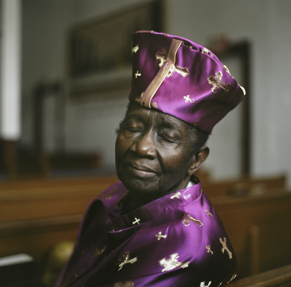 "The Rev. Susie Elliott, 83, at Mt. Paran Baptist Church at 12 Schaefer Street in Brooklyn. Pastor Susie discovered early on that simply being ordained would not guarantee a woman a spot at the pulpit. Often women were ""benched"" while the men led the congregation."