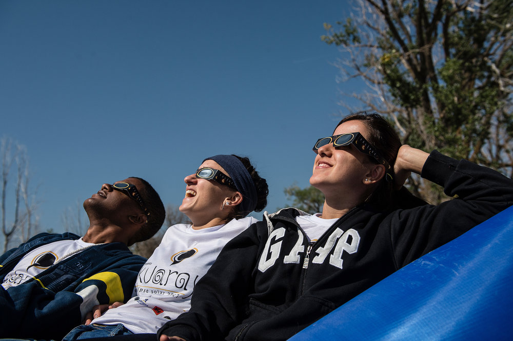 Members of a team from the University of Brasilia react to the moment of eclipse totality.