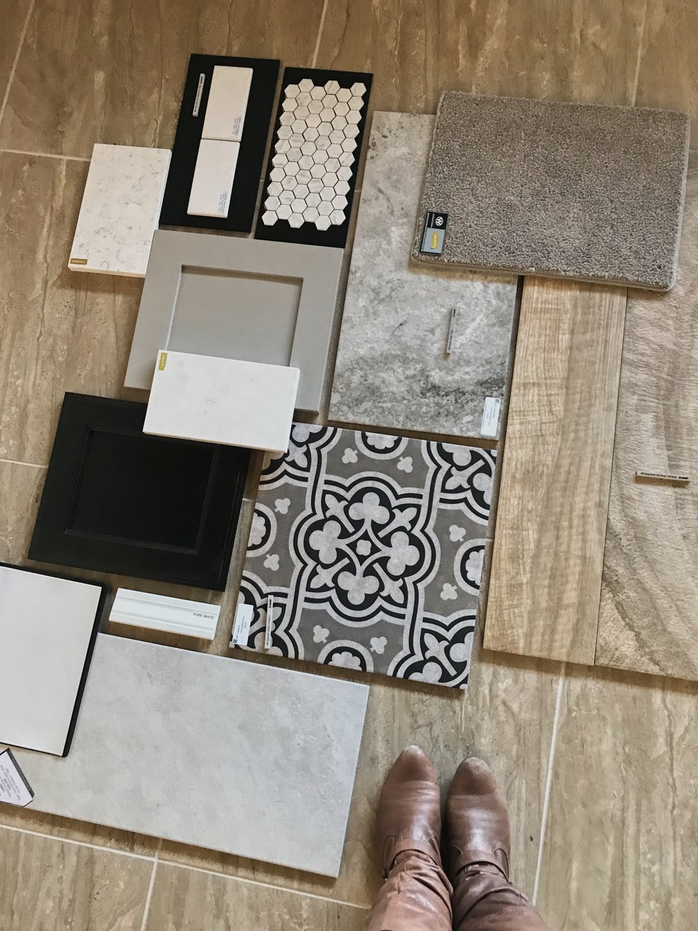 ABOVE:  These are all the finishes we chose for the inside of the house all spread out together. The wood tile will be the main flooring, the detailed tile is in the hall baths, and the cement-look tile is in our master bath and laundry room. The warm gray shakers are the kitchen cabinets and master bathroom cabinets. Classic white subway as the kitchen backsplash and shower wall tile, and a soft white quartz for all the countertops throughout.