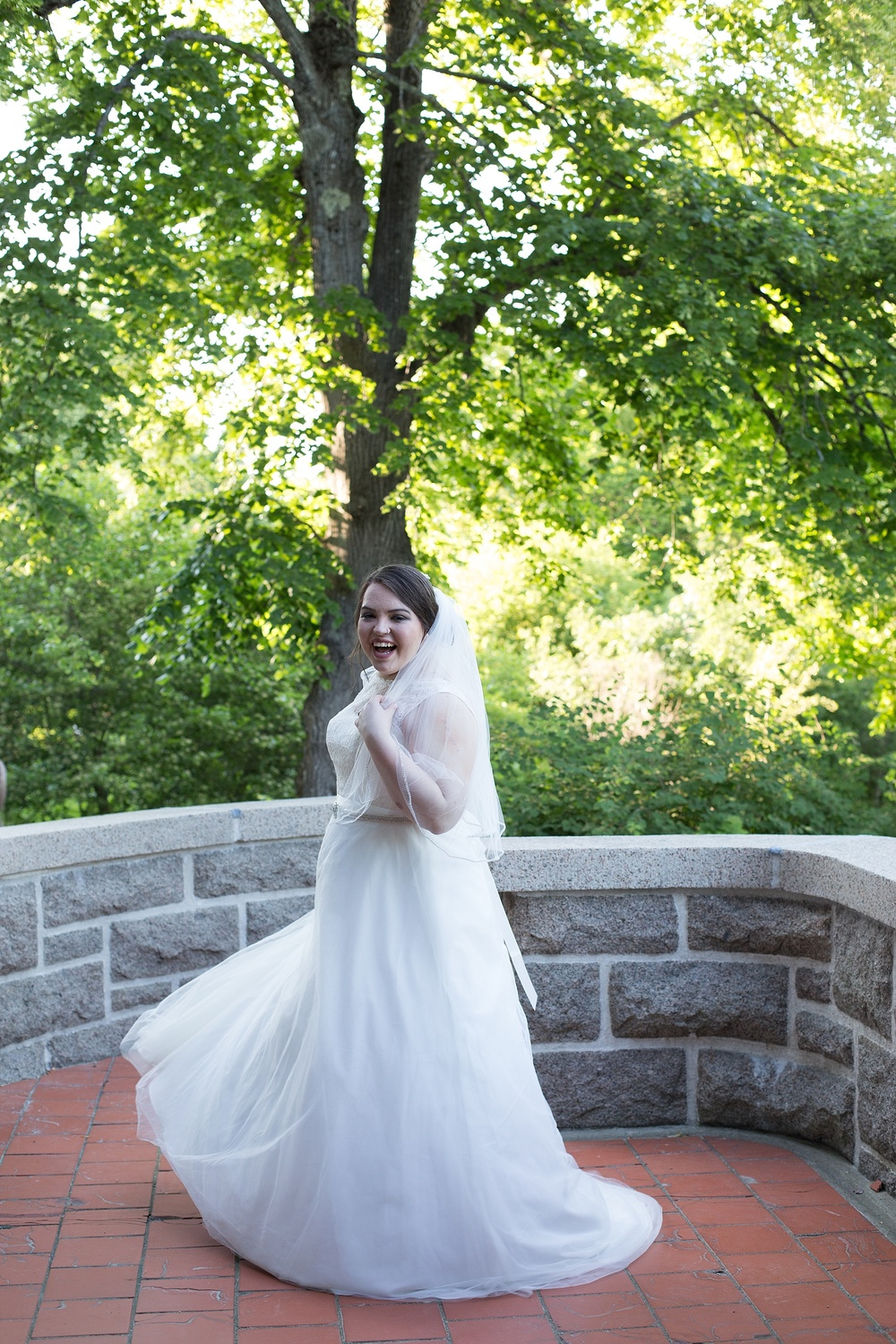 Bride twirling in gown