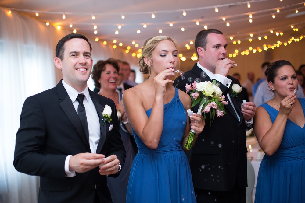 Bridal party blowing bubbles