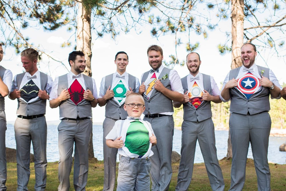 Groomsmen with super hero shirts
