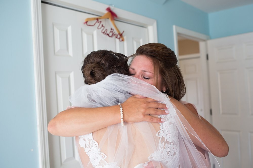 mom hugging bride