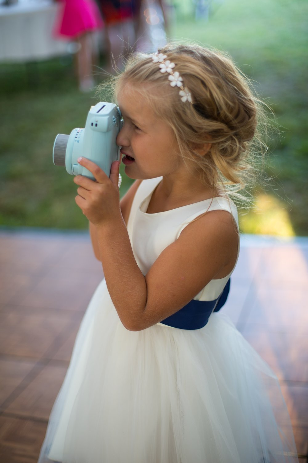 flower girl with camera