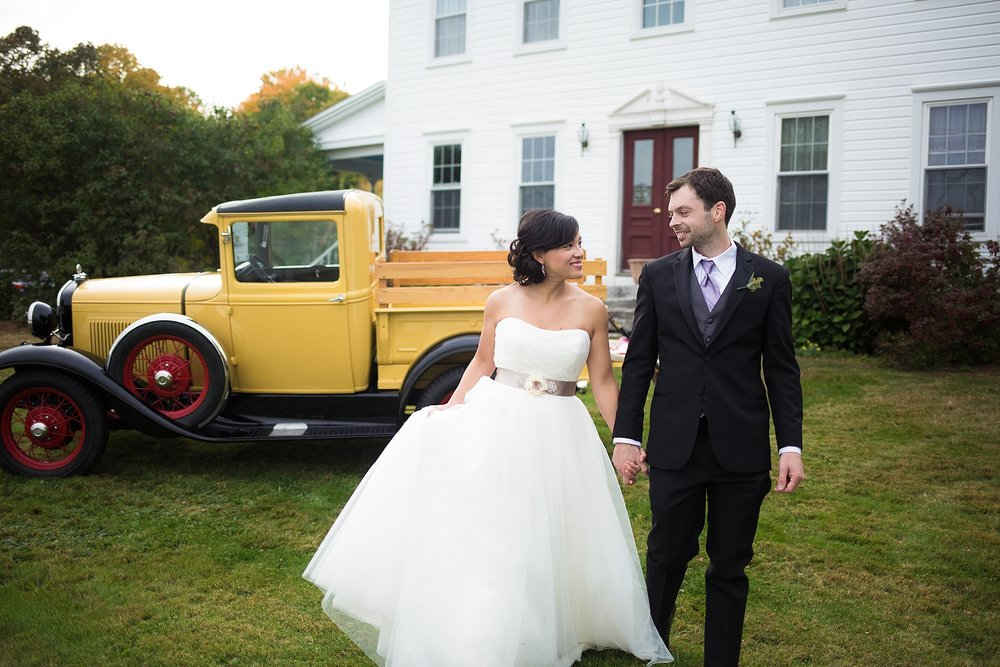 Bride and groom with antique car