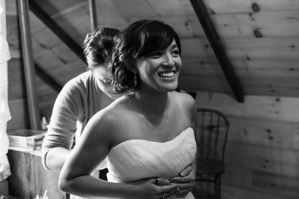 bride getting in dress
