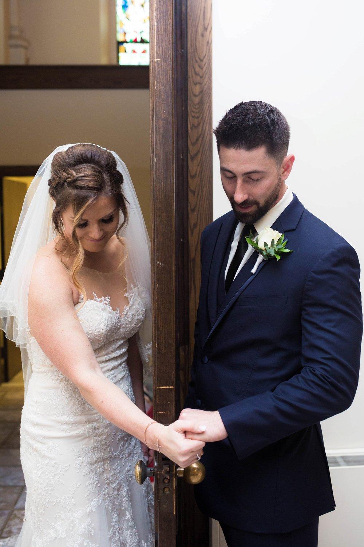 Couple praying before wedding