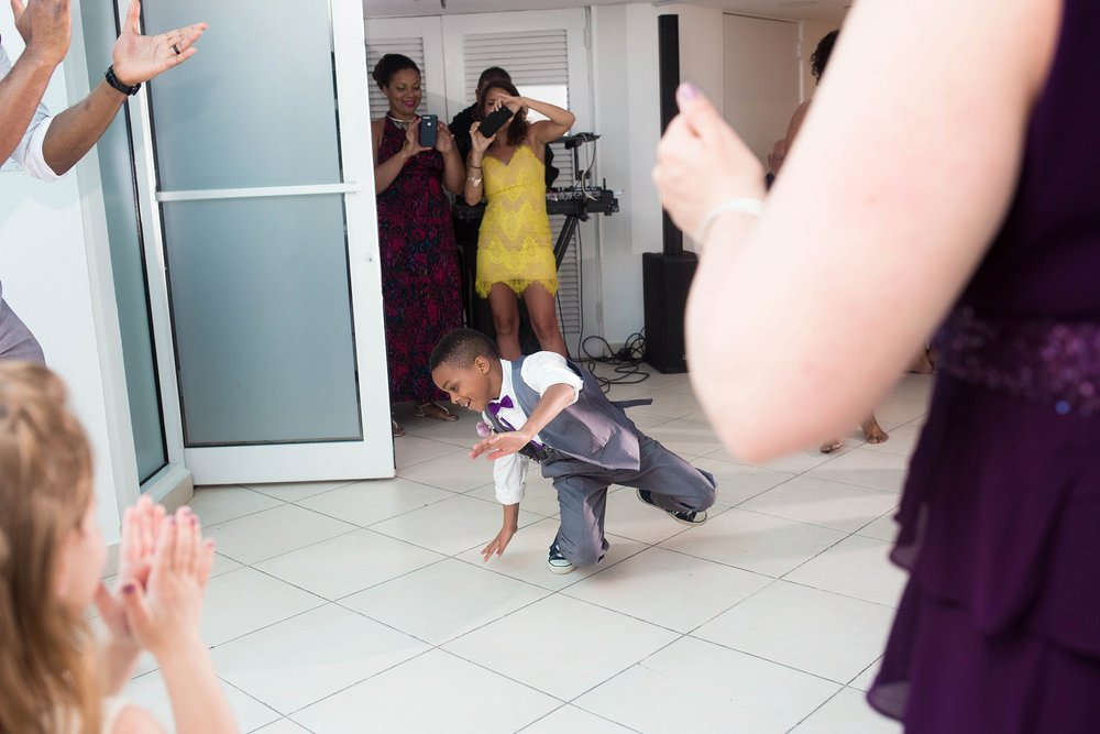 kid breakdancing at wedding