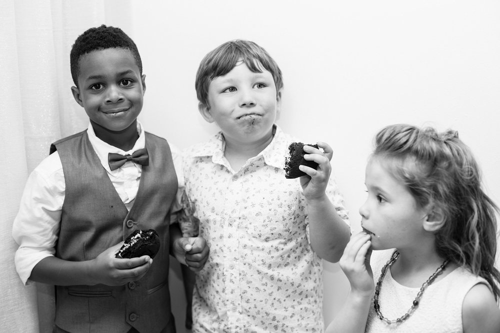 kids eating wedding cake