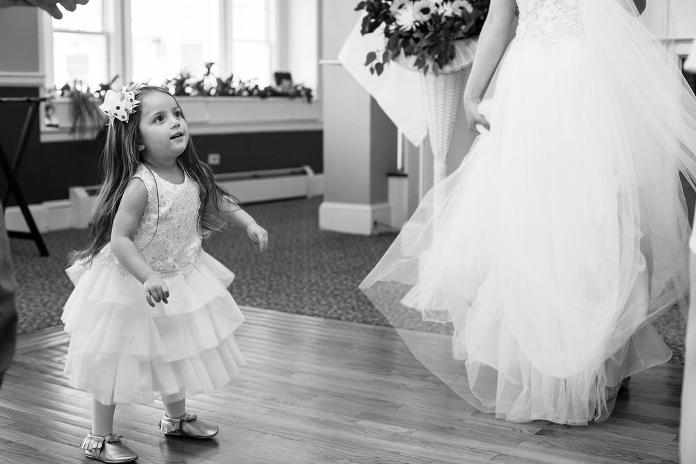 flower girl and bride dancing