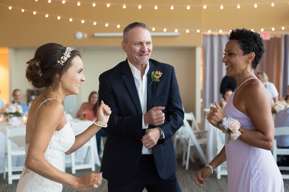bride dancing with parents