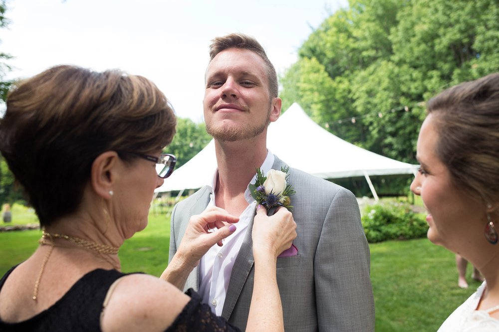 mom helping with boutonniere