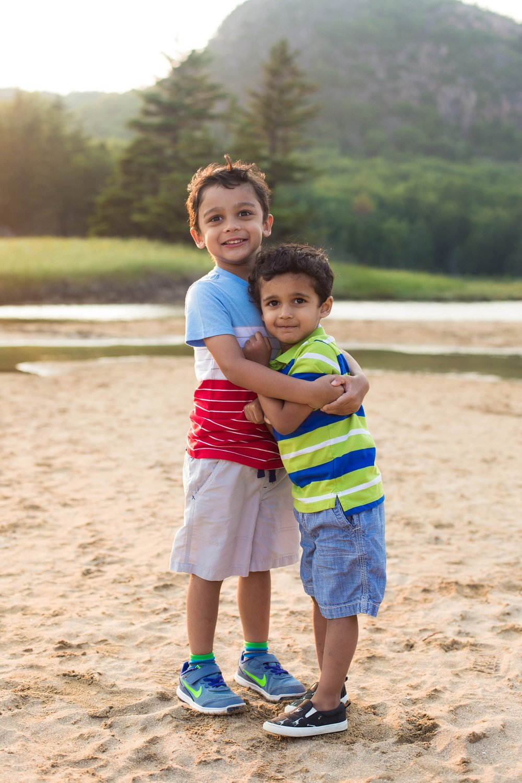 brothers on sand beach