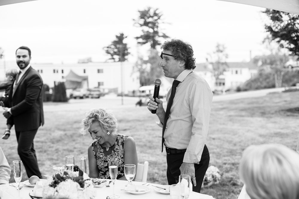 father making toast at wedding