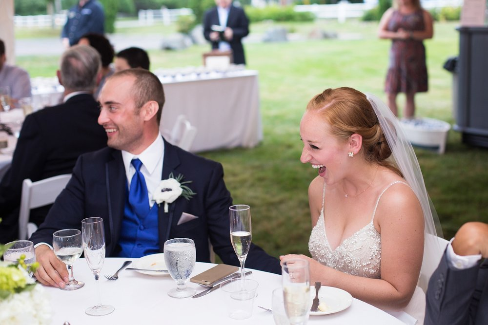 bride laughing during toasts