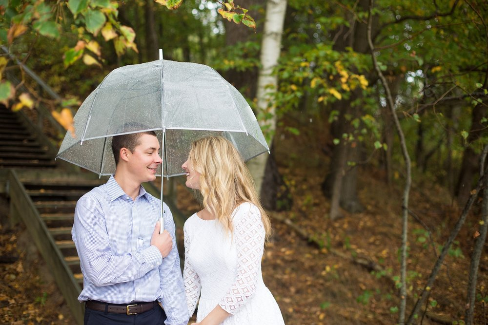 umbrella in engagement photos