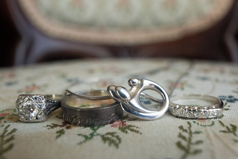 couples rings with baby necklace