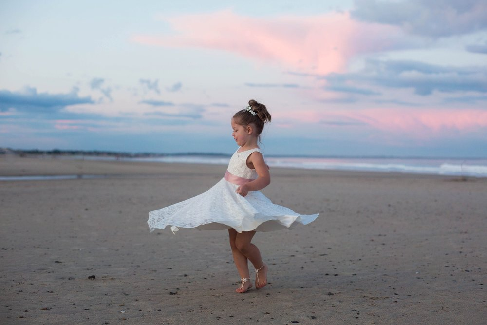 flower girl twirling at sunset