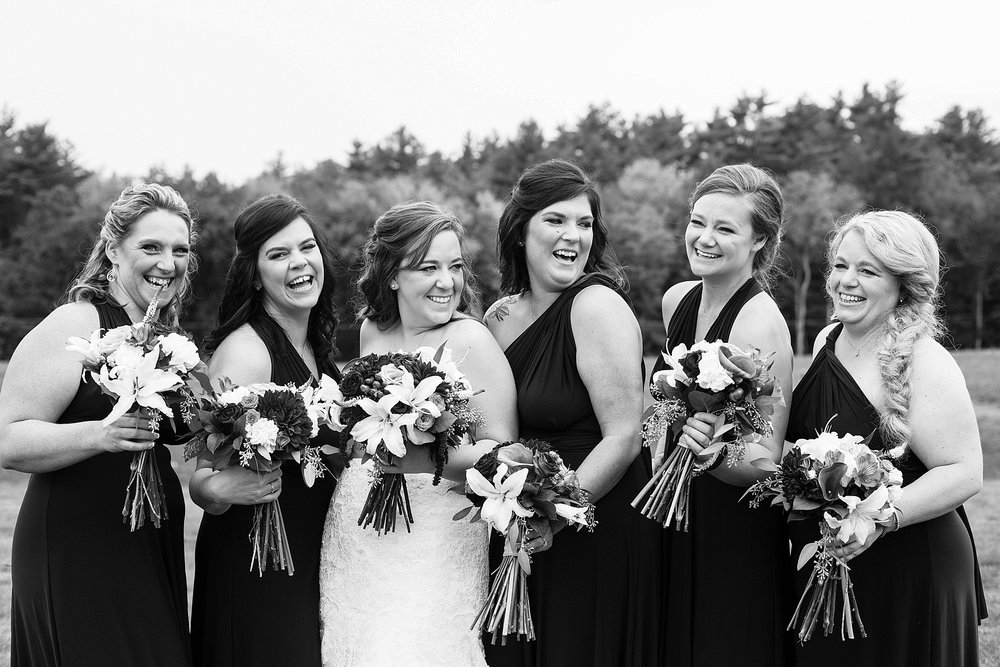 bride with bridesmaids on wedding day